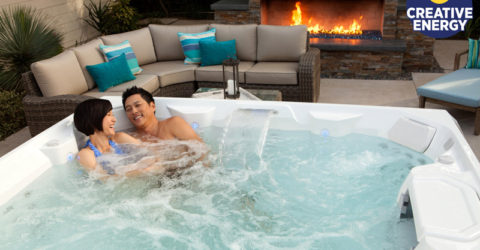 A couple enjoying their new 2018 Limelight hot tub.
